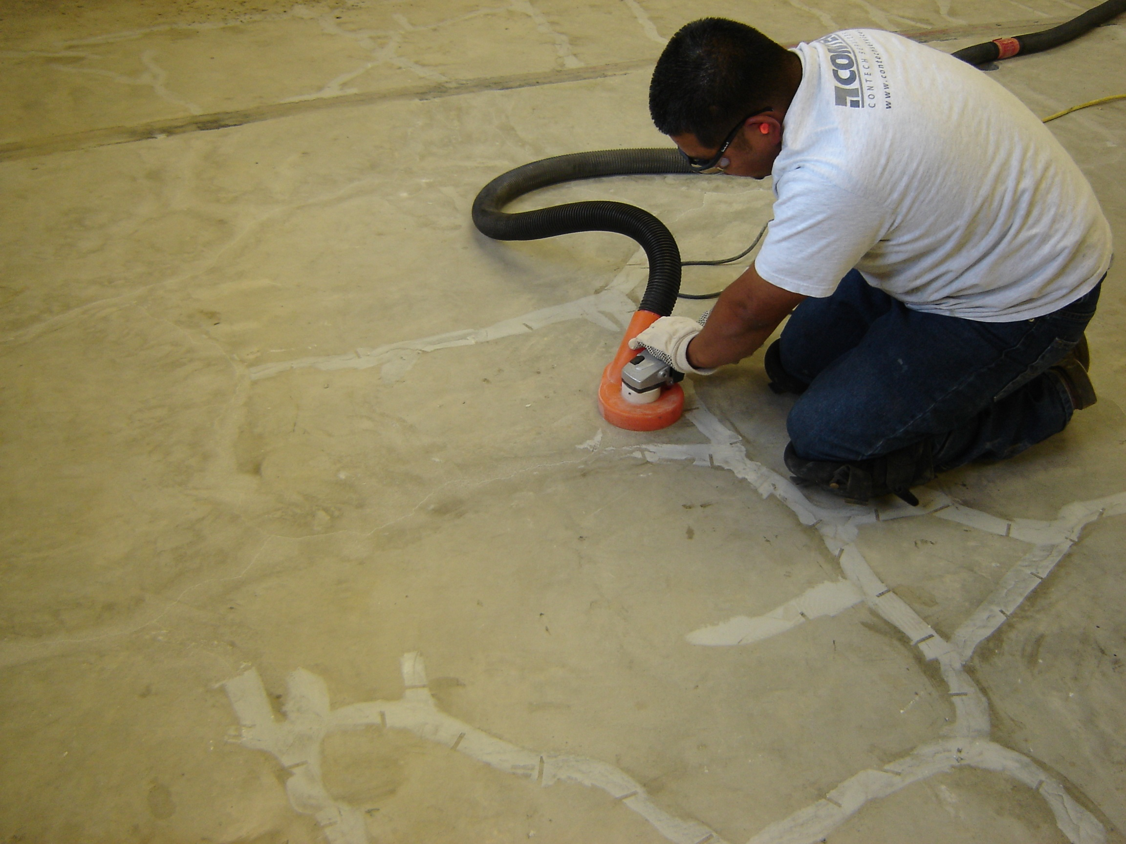 removing surface seal epoxy on an industrial floor repair.jpg